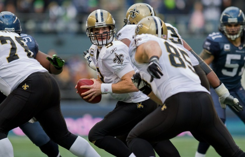 Drew_Brees_prepares_to_pass_vs_Seahawks_in_2011_NFC_wildcard.jpg